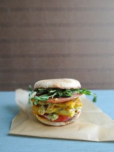 """The perfect vegan Breakfast Sandwich: tofu """"egg,"""" melted vegan cheese, tomato, and meat-free Canadian bacon on a toasted English muffin. This goes against every aspect of eating clean but it sounds sooo good Vegan Foods, Vegan Dishes, Vegan Vegetarian, Vegetarian Recipes, Vegan Egg, Tofu Recipes, Wrap Recipes, Recipes Dinner, Tofu Breakfast"""