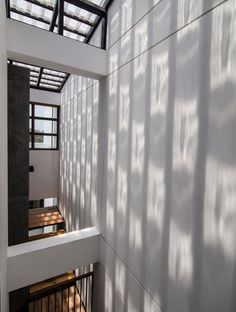 global architects realizes vertical four-storey vacation home in hanoi