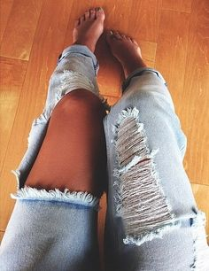 I'm going to distress a pair of Levi's almost like this. I love the large open rip on one side and shredded rips on the other. It balances out nicely.