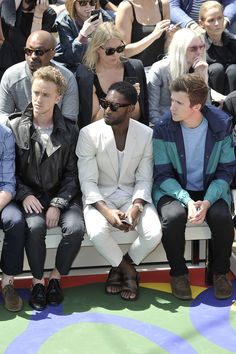 Tom Felton,Tinie Tempah and Greg James sit on the front row at Burberry Prorsum SS15 during London Collections: Men at Kensington Gardens on...