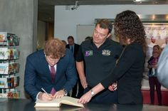 Prince Harry signing the VIP Visitor book