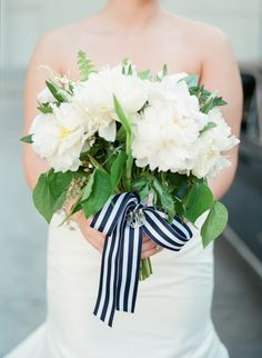 Navy + white stripes | As we transition into fall, it's no surprise that we have seasonal wedding trends on the brain (hello, autumnal bouquets!). But what about elements that transcend seasons, nay transcend time? One of the first things that comes to mind is navy and white striped details — they're timeless, fun, and always chic — both shoreside and beyond. more wedding […]