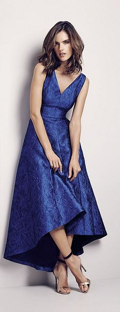 Alessandra wears a billowing midi dress in midnight blue...