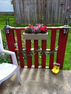 Pallet Fence with Flower Pot and Lantern