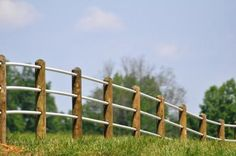Fence that will be on property. Will need to tie gated entrance into fence. (Fence will be wood posts with black pipe)