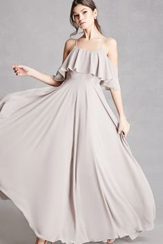 A chiffon dress featuring an open shoulder, adjustable cami straps, a flounce layer that leads into short sleeves, round neckline, flowy skirt, and fully lined. This is an independent brand and not a Forever 21 branded item.
