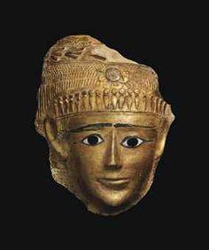 AN EGYPTIAN GILT CARTONNAGE MUMMY MASK  PTOLEMAIC PERIOD-ROMAN PERIOD, CIRCA 1ST CENTURY B.C-1ST CENTURY A.D.