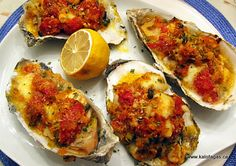 Baked oysters with tomatoes, capers and feta