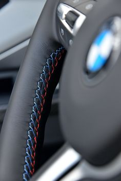 This use of M-series colors for the thread on this steering wheel stitching is a phenomenal detail.