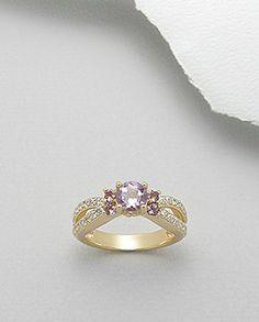 Inel deosebit argint aurit - ametist rozInel deosebit, regal, realizat din argint 925 aurit si decorat cu superbe cristale semi-pretioase de ametist roz si zirconii albe.Placat cu aur galben de 14 k.Latime maxima: 6 mm.Greutate: 4,9 gr.Masuri disponibile: 6,7 (SUA). Aur, Gold Rings, Rose Gold, Jewels, Bijoux, Gemstones, Jewlery, Jewerly, Jewelry