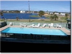 Entire home/apt in Carolina Beach, US. Recently redone Condo, beachy colors, very nice!  Practical vacation spot - 1 bedroom price but sleeps 6 with a set of bunks in a hallway nook and an innerspring mattress in the queen sleeper sofa!  2nd Row with limited ocean views