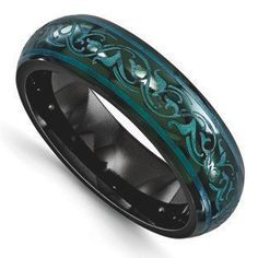 Women's Anodized Teal Scroll Design Black Ti Titanium 6MM Domed Ring Jewelry Gemologica.com offers a unique selection of Edward Mirell wedding rings. Award-winning rings crafted in titanium all of which are designed, engineered and manufactured in the USA. Accented with gemstones, diamonds and anodized to produce the most beautiful of colors. Our Edward Mirell gallery jewelry collection of deals can be reviewed here: www.gemologica.com