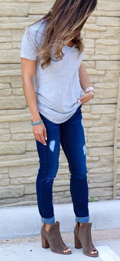 #fall #outfits gray shirt and distressed blue denim jeans and pair of brown leather boots