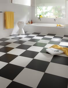 Check out this checkerboard vinyl pattern, perfect for that classic #bathroom look. #Flooring