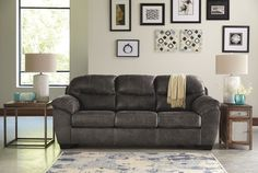 Ashley Havilyn Faux Leather Sofa in Charcoal -- You can find out more details at the link of the image. (This is an affiliate link)