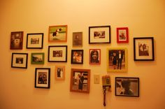 hallway with old pics of our families by EandG - DECOmyplace Projects