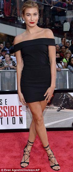 Hailey Baldwin plants smooch on Ireland Baldwin at MI5 Rogue Nation premiere | Daily Mail Online