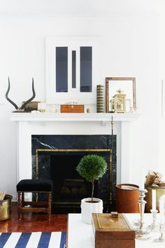 +Stylish Fireplace Mantel Design (@ Tommy Smythe) // Mantel display in living room using modern art and vintage collectibles. Crisp colours and shapes keep the look fresh. Modern Fireplace Mantles, Fireplace Mantle Designs, Mantle Deco, Fireplaces, White Fireplace, Traditional Fireplace, My Living Room, Home And Living, Living Room Decor