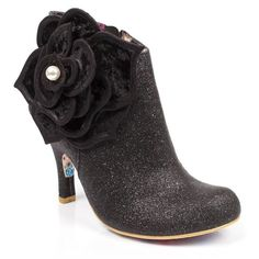 <p>Unleash your eleganza extravaganza in these super sophisticated glittering ankle boots. Trimmed with an opulent velveteen flower with luxe applique petals, pearl detailing, set upon a smooth glittering upper.</p> <ul> <li>Ankle boot</li> <li>High heel</li> <li>Glittery upper</li> <li>Zipper fastening</li> </ul>