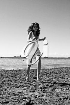 iPHOTOS.com - Pretty woman in white dress on beach in Limassol, Cyprus.