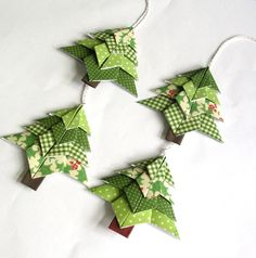 Neat Origami Christmas Decorations - http://www.ikuzoorigami.com/neat-origami-christmas-decorations/
