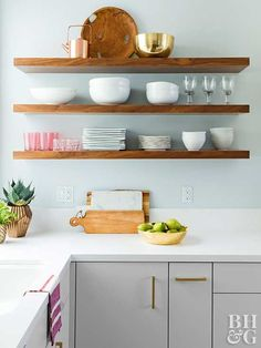 Reworking this kitchen's floorplan resulted in high style and a better flow without having to remove walls. Gold accents and a touch of pink make the refreshed kitchen sparkle.