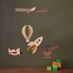 A modern addition to any child's room, this Petit Collage transportation mobile is laser-cut from sustainably harvested bamboo plywood, an earth-friendly renewable resource. This deluxe bamboo mobile also features 100% wool felt pieces that easily slot into place adding a pop of color to the room.