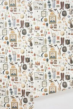 This wallpaper serves as wall covering, art collection and curiosity shop all in one madcap pattern. New Antiquitarian Wallpaper - Via #anthropologie