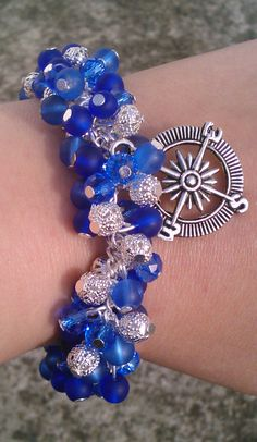 blue and silver cluster bracelet with silver compass charm
