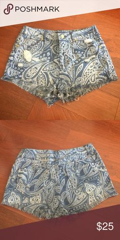 "Cello Paisley Print Jean Shorts In great used condition. Very cute paisley print jean shorts by Cello Jeans. Size 9. 78% Cotton, 20% Polyester, 2% Spandex. Waist: 14.5"". Inseam: 1 3/4"". Cello Jeans Shorts Jean Shorts"