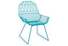 This modern outdoor chair feels so fresh in a bold peacock blue!