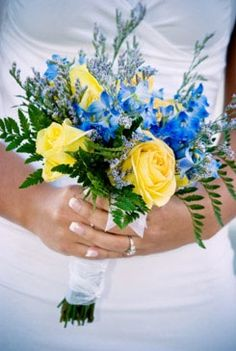 I imagine my bouquet to look something like this, just a little fuller. The yellow and blue combination are beautiful together and great for a beach wedding.