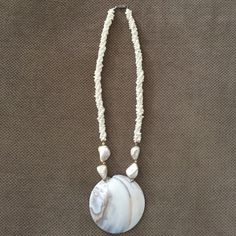Shell necklace Make a statement with this necklace!  Beautiful combination of shell and pearls.  Great for the summer or anytime. Jewelry Necklaces