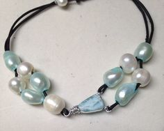 A personal favorite from my Etsy shop https://www.etsy.com/listing/230470476/wire-wrapped-larimar-freshwater-pearl