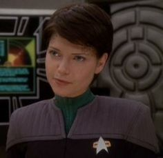 """She's a Dax. Sometimes they don't think; they just do.""  - Ben Sisko, 2375  Ezri Dax was a joined Trill and the ninth host of the Dax symbiont. She served as counselor aboard Deep Space 9, beginning in 2375. She was joined to Dax shortly after the death of its previous host, Jadzia. (DS9: ""Image in the Sand"", ""Shadows and Symbols"", ""Afterimage"") Played by Nicole de Boer"