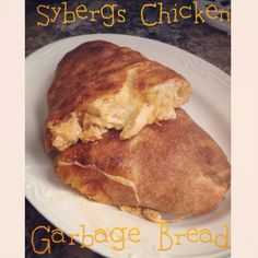Spicy chicken & cheese garbage bread..found recipe on here and decided to make it my own using sybergs sauce. I also used Pilsbury pizza crust for a faster option. Preheat oven 425... Cook grilled chicken and pour 1/4 cup of sybergs sauce. Let simmer. Roll out pizza dough and spread some ranch. I added alittle more sybergs too. Top with chicken and mozzarella or any cheese you prefer. Roll up keeping sides tucked in. I baked until it was golden brown.