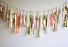 Tassel garlands are a great way to add a pop of fun and color to your nursery, kids room or party! This pink and gold tassel garland from @paperfoxla is so on-trend!