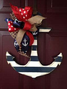 This super cute anchor is hand painted with a navy and white stripe print. It is embellished with an accent bow in a red, blue, white, and Wooden Doors, Wooden Door Hangers, Anchor Wreath, Nautical Wreath, Nautical Theme, Nautical Anchor, Anchor Decorations, Dyi Decorations, Anchor Crafts