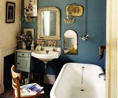 Small bathroom space, navy blue walls.