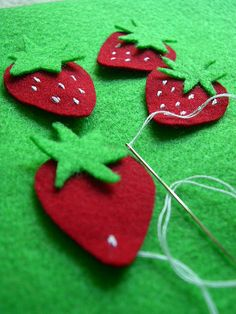 Sweet little felt strawberries in the making!