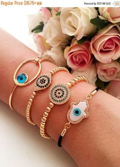 https://www.etsy.com/listing/553243915/promo-evil-eye-bracelet-gold-evil-eye Evil eye bracelet, gold evil eye bracelet, hamsa beacelet, beaded evil eye bracelet, gold zirconia bracelet, nazar boncuk jewelry, evil eye jewelry These evil eye bracelets is totally handmade.  #evileyebracelet #evileyejewelry #goldbracelet #goldevileyebracelet #zirconiabracelet #nazarboncukjewelry #evileyes #hamsabracelet #zirconiabracelet #charmbracelet #adjustablebracelet #evileyes #evileye #hamsahand