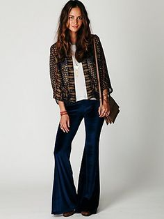 i could never pull off royal velvet bell bottoms but this chick rocks it.
