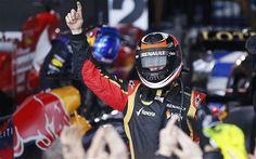 Kimi Raikkonen celebrates winning the opening grand prix of 2013 in his Lotus