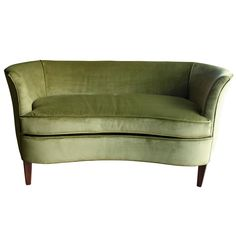 Sculptural 1960s Midcentury Green Velvet Settee   From a unique collection of antique and modern loveseats at https://www.1stdibs.com/furniture/seating/loveseats/