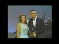 ▶ Johnny Cash & June Carter - Jackson - YouTube  Just noticed Johnny's Right hand picking position, must try that.