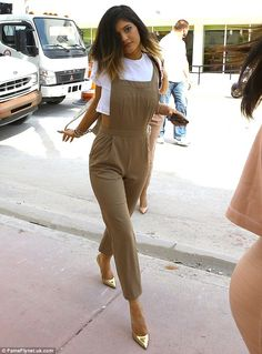 Not true: Kylie Jenner recently denied claims that she has had plastic surgery, pictured last week in Miami