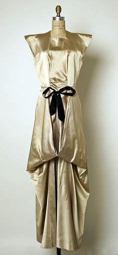 Charles James evening dress, (circa 1941-42).  Gold satin.  Accentuation of the shoulders - classic for this period.