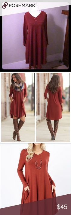 "REDUCED. Rust long sleeve V neck dress w/pockets Rust long sleeve v neck tunic dress with pockets. Has a beautiful drape to make a gorgeous silhouette. This dress will look good on all body types. Made of 67% polyester, 28% rayon, 5% spandex.  Sizes are bust M-18"", L-19"", XL-20"". Length is M-39"", L-40"", XL-41"". Hits right at or above knee length. The perfect dress to wear now with tights and boots and to transition into spring.  Infinity Raine Infinity Raine Dresses Long Sleeve"