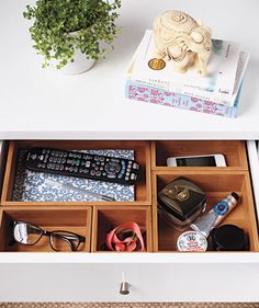 A NiGHTSTAND DiViDED Can't stand the stress of a messy bedside table? Find solace in compartments with the right setup, There's A PLaCE For your REMoTE, GLaSSES, NoTEPaD (to capture 3 A.M. revelations), PHoNE, and BEauTY EPHEMERa, Leaving The Top Free For Lamp, Book, and Peace Of Mind  ___To buy: Bamboo drawer-organizer boxes, $25 for five assorted sizes, sevilleclassics.com.