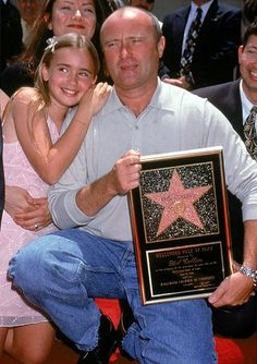 Lily Collins with her father Phil Collins